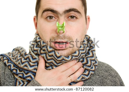 A patient man with a stuffy nose on a white background. - stock photo