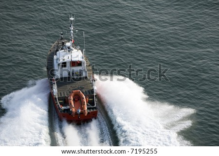 A patrol boat shot from above while travelling fast. - stock photo