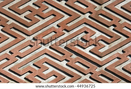 A pattern found on a traditional Chinese house, that forms a maze.  It founds intricate patterns in a red and white. - stock photo