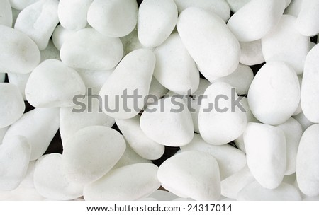 A pattern of white round sea stones. - stock photo