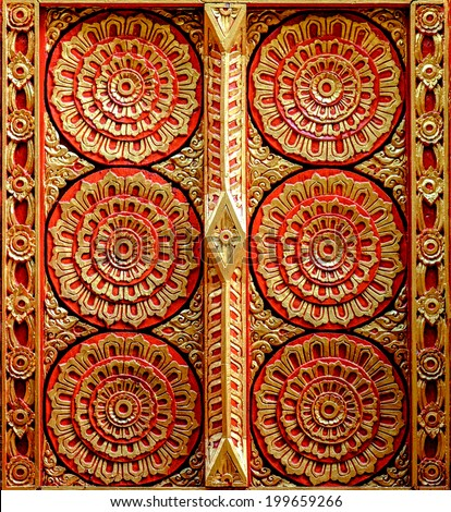 A pattern on the wall of a buddhist temple - stock photo