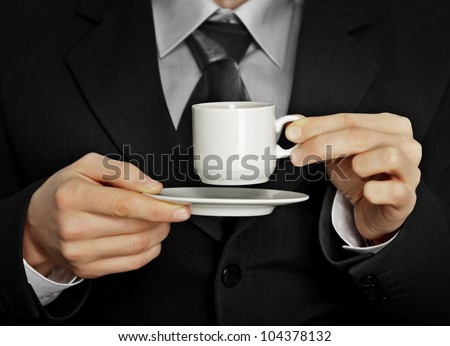 A pause in the work - a cup of coffee - stock photo