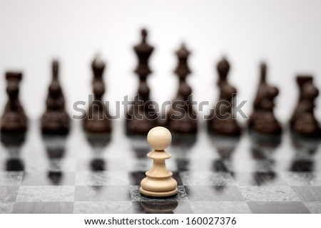 A pawn on the chequer before the shapes. - stock photo