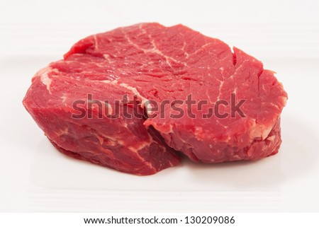 a peace of raw filet beef on a white background - stock photo
