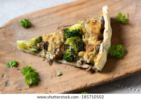 a peace of vegan quiche with broccoli and mushrooms - stock photo
