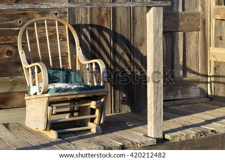 a peaceful setting for a rocking chair - stock photo