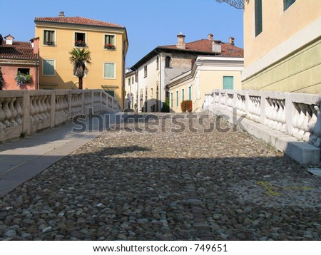 A pebbled bridge in Italy