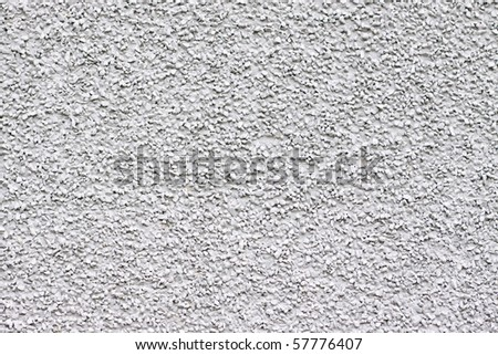 A pebbly, gritty white grey texture or background. - stock photo