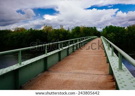 A pedestrian bridge over the Delaware River in Portland, Pennsylvania. - stock photo