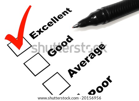 A pen is checking of the word Excellent in a survey. The check mark is in red. - stock photo
