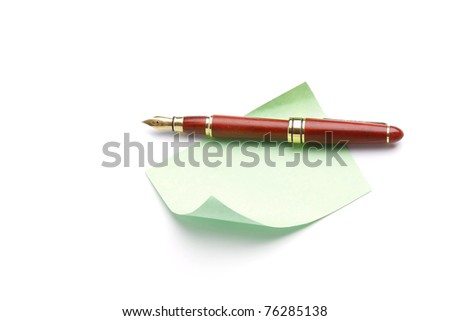 A pen on a piece of paper - stock photo