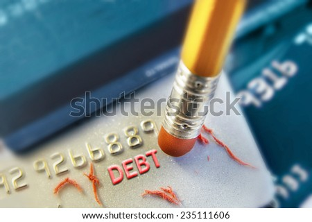 "A pencil erasing credit card ""debt"" - stock photo"