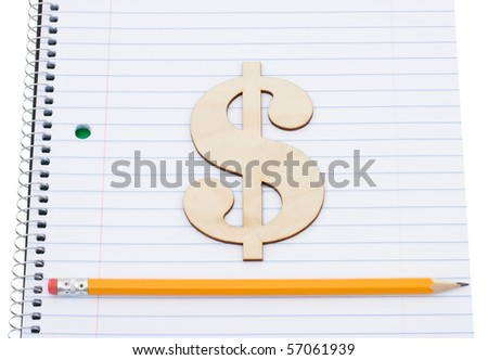 A pencil on a workbook with a dollar sign isolated on a white background, education scholarship - stock photo