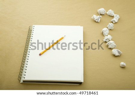 a pencil on notebook and a question  mark - stock photo