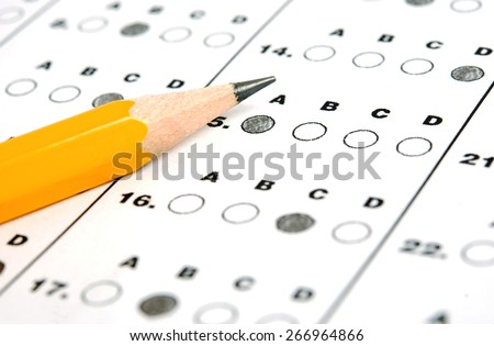 A pencil sitting on a test bubble sheet - stock photo