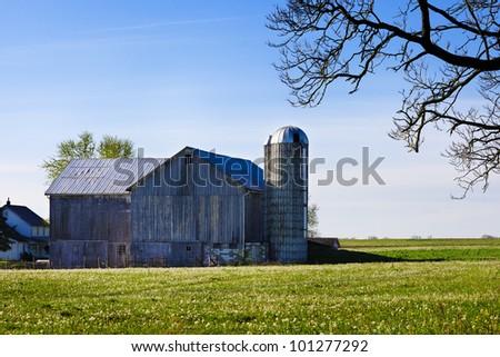 A Pennsylvania amish barn on a spring morning - stock photo
