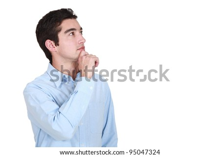 A pensive young man - stock photo
