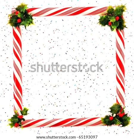 A peppermint frame and holly corners on a sparkly background. - stock photo
