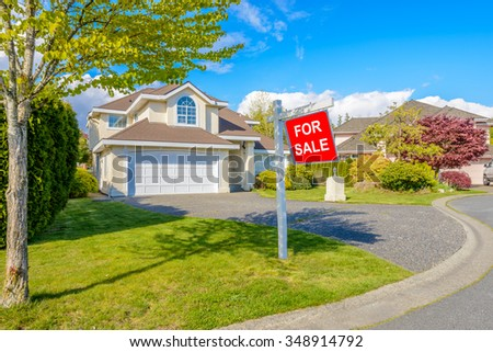 A perfect neighborhood. Houses for sale in suburb at Spring in the north America. - stock photo