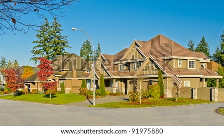 A perfect neighborhood. Houses in suburb at Fall in the north America - stock photo
