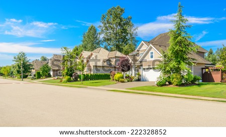 A perfect neighborhood. Houses in suburb at Spring in the north America - stock photo