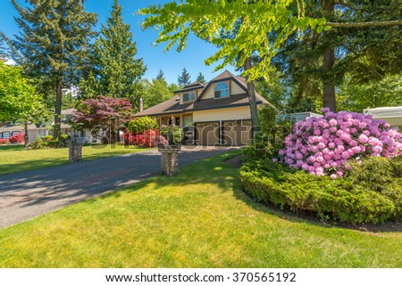 A perfect neighborhood. Houses in suburb at Spring in the north America. Great outdoor landscape. - stock photo
