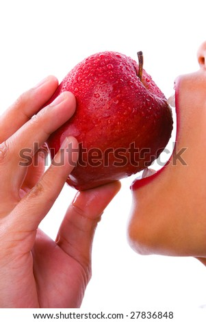 A perfect skin of a woman who stat biting a red apple.