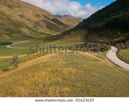 a perfect winding road through the hills - stock photo