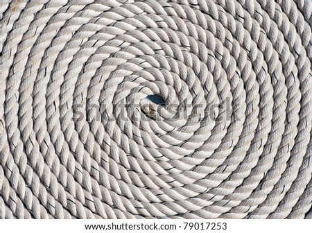a perfectly circular spirally coiled nautical rope - stock photo