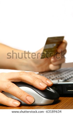 A person at home using computer for internet shopping - stock photo