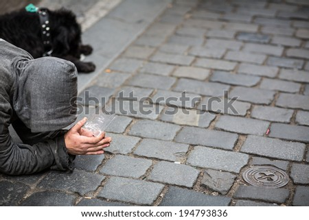 A person begging for money on the street - stock photo