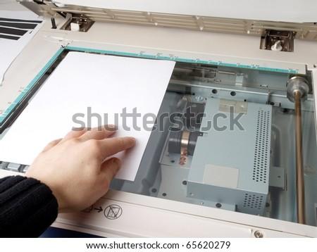 A person handling a multi purpose copier machine - stock photo