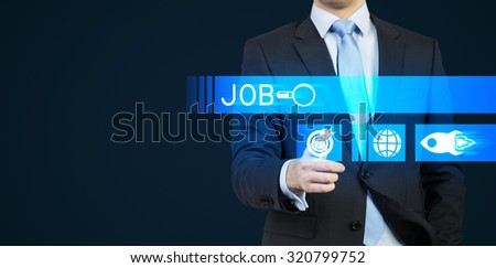 A person in a suit is pushing the hologram button which is symbolised the search. A concept of the Job hunting. Dark background.