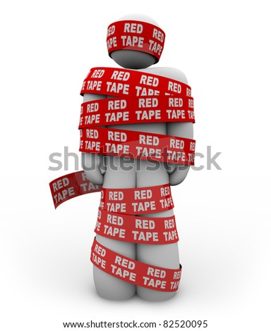 A person is wrapped up in red ribbon with the words Red Tape repeated, representing getting caught up in a mess of bureaucratic rules, regulations and procedures while trying to get something done - stock photo