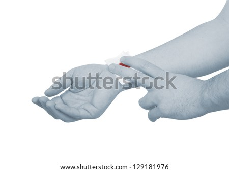 A person medically dressed with a cotton ball and bandage over a wound. Isolated on white bacground. - stock photo