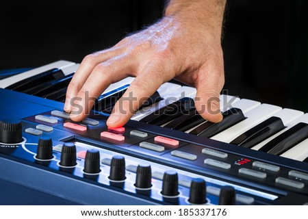a person playing a synthesizer  - stock photo