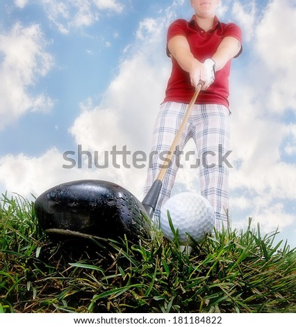 a person playing golf as seen through a wide angle lens - stock photo