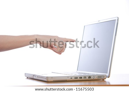 A person pointing at a laptop screen