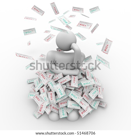 A person sits in a pile of bills, thinking of a way out - stock photo