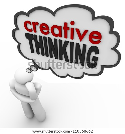 A person thinks of the words Creative Thinking to represent brainstorming, thought, creativity, inspiration, innovation and invention - stock photo