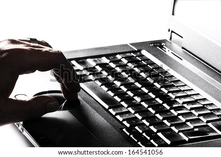 A person using a laptop to work - stock photo