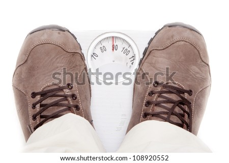 a person weighing themselves to know how many kilograms weight