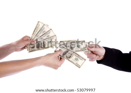 A person with bare arms giving money to a person in a business suit. - stock photo