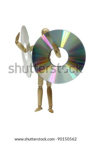 A person (wooden doll) holding giant compact disc (CD) - stock photo