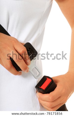 A persons fastens the seat belt. All on white background - stock photo