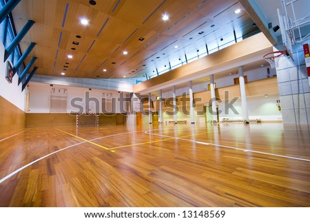 A perspective view of basketball indoor sport court - stock photo