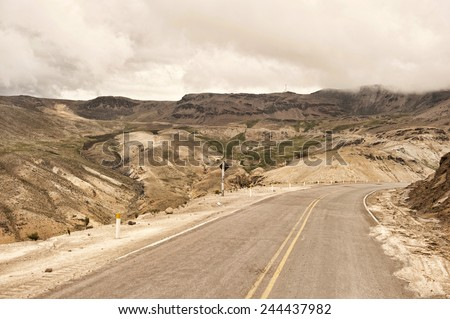 A Peruvian roadway near Arequipa Peru in the Caylloma Province on a cloudy day. - stock photo