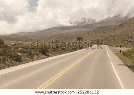 A Peruvian roadway near Arequipa Peru in the Yura district on a cloudy day. - stock photo