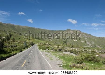 A Peruvian roadway near Arequipa Peru near Chivay on a sunny day. - stock photo