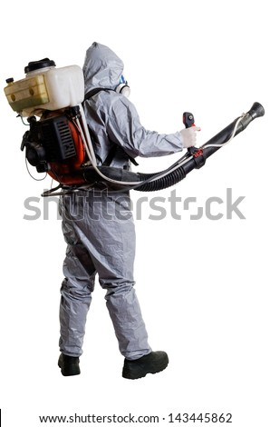 A pest control worker wearing a mask, hood, protective suit and dual air filters holding a hose to help exterminate rats and other vermin. - stock photo